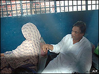 Amanullah Aman and his wife Sabera sit inside a prison van