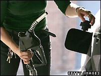 Car at petrol pump - file photo