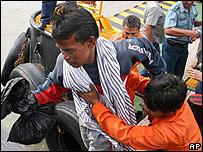 A ferry disaster survivor arrives in Surabaya, East Java, Indonesia, on 3 January 2007