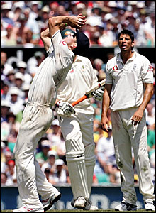 Kevin Pietersen (left) takes the catch to dismiss Stuart Clark while Sajid Mahmood (right) looks on