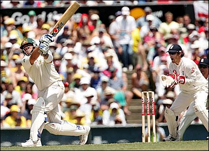 Shane Warne (left) misses and Chris Read waits to pounce