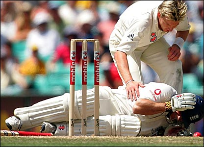 Australia paceman Brett Lee checks on Andrew Strauss after hitting him with a bouncer