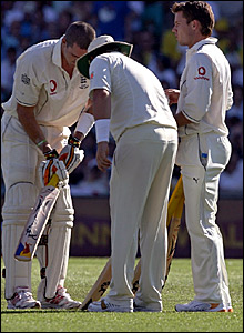 Kevin Pietersen (left) checks out a new bat while Shane Warne (centre) and Geraint Jones look on