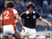 Wales' Paul Price (left) prepares to challenge Scotland's Kenny Dalglish at Hampden in the 1980 Home Internationals Championship