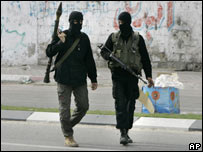 Two armed and masked militants