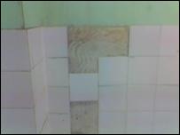 Half-tiled bathroom wall
