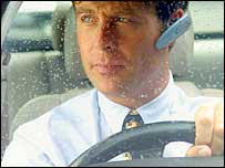 Image of man in a car using a Bluetooth headset