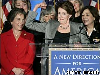 Nancy Pelosi flanked by other Democratic Congressional members