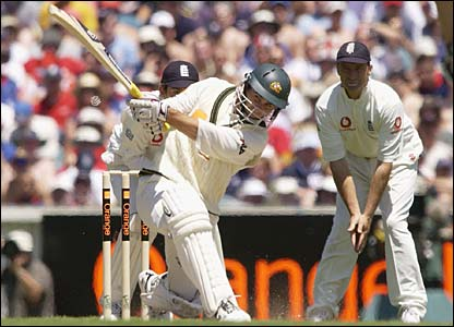 Justin Langer hits a four on his way to 250 against England in Melbourne