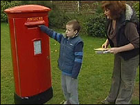 Gareth Scott with his mum, Denise, and their new postbox