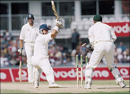 Alec Stewart is bowled out by Shane Warne