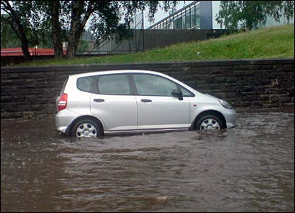 Car on a flooded street
