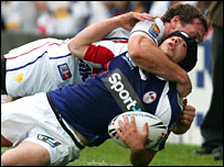 Great Britain's Gareth Ellis tackles France's Olivier Elima