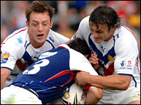 James Roby and Jon Wilkin try to stop France's Aurelien Cologni