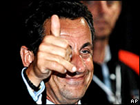 French President Nicolas Sarkozy gives the thumbs-up after the summit