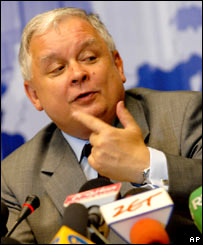 Poland's President Lech Kaczynski gestures while speaking during a final media conference at an EU summit in Brussels