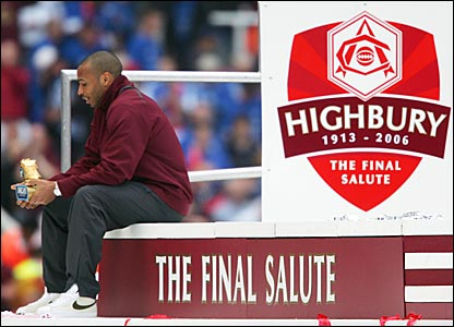 Thierry Henry of Arsenal examines his Golden Boot trophy for the leagues top goal scorer