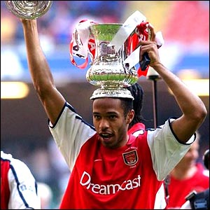 Thierry Henry celebrates with the FA Cup in 2002