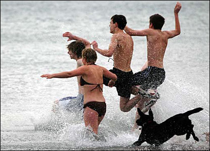 Swimmers entering the sea
