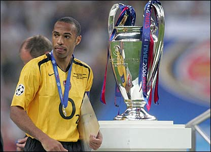 Thierry Henry looks away from the Champion League trophy in 2006
