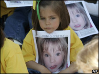 A girl holding a poster of Madeleine McCann