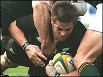 Richie McCaw powers over to score the All Blacks' opening try
