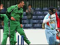 Roger Whelan celebrates bowling Sachin Tendulkar in Belfast