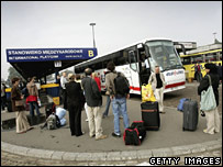 Workers boarding a coach to London