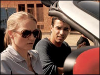 Sarah Wynter and Phillip Rhys as Kate Warner and Reza Naiyeer in 24