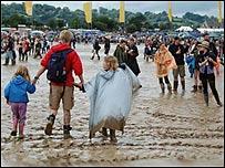 People in muddy field