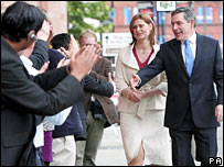Sarah and Gordon Brown arrive at the conference