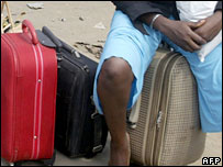 A Nigerian traveller with luggage