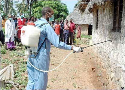 A Kenyan man sprays insecticide