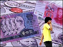 Man in front of collage of yuan notes