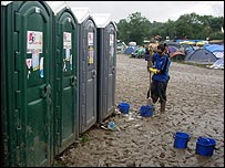 Cleaners prepare to service toilets