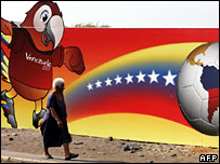 A woman walks past a billboard of Guaky, the mascot of the Copa America 2007, in Maracaibo, Venezuela