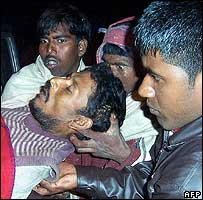 An injured Indian man is brought to hospital in Assam state capital (6 January 2007)