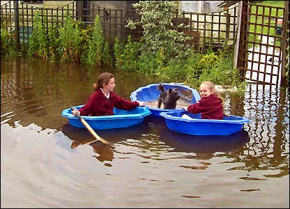 Children play in the flood. Picture by Eric McGough