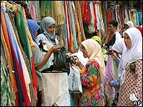 Women selling scarves at a market in Kuala Lumpur (file photo)