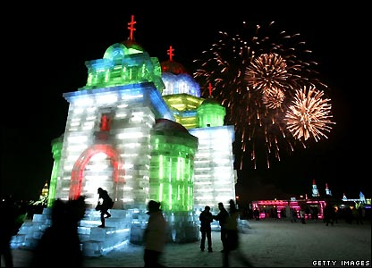 Fireworks over large model of Orthodox church