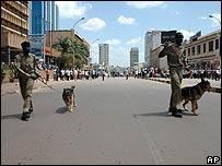 Ugandan police with dogs patrol Kampala's streets