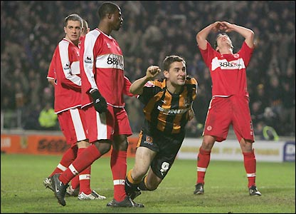 Nicky Forster celebrates after getting between Boro's defenders