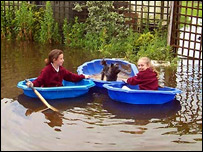 girls in boats during flood in Hogsthorpe (Picture by Eric McGough)