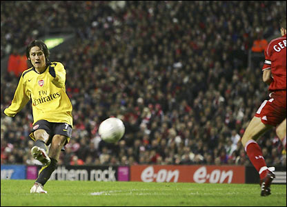 Tomas Rosicky sends the ball goalwards in the 37th minute