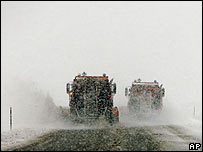 A pair of snowploughs clear a road in Colorado after heavy snowfall (5 January)