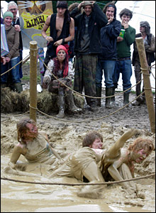 People rolling in the mud at Glastonbury