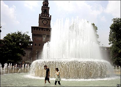 People walking in Milan fountain