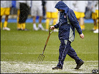 A groundsman inspects the Madejski Stadium pitch on Saturday afternoon