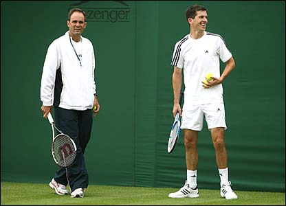 Tim Henman warms up with coach Paul Annacone