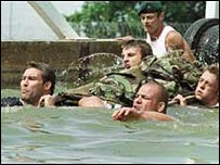 Jason Leonard and Andy Robinson lead the way with the Marines in 1999